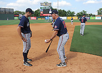 Infielder Kyle Kubitza (39) of the Rome Braves, left, gets some instruction from manager Randy Ingle (12) before a game against the Greenville Drive on May 7, 2012, at Fluor Field at the West End in Greenville, South Carolina. Kubitza is Atlanta's No. 17 prospect according to Baseball America. Greenville won, 11-5. (Tom Priddy/Four Seam Images)