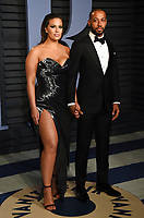 Ashley Graham, left, and Justin Ervin arrive at the Vanity Fair Oscar Party on Sunday, March 4, 2018, in Beverly Hills, Calif. (Photo by Evan Agostini/Invision/AP)