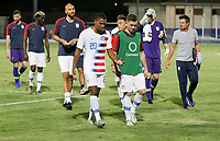 GEORGETOWN, GRAND CAYMAN, CAYMAN ISLANDS - NOVEMBER 19: Reggie Cannon #20 and Wil Trapp #6 of the United States chat while exiting the pitch during a game between Cuba and USMNT at Truman Bodden Sports Complex on November 19, 2019 in Georgetown, Grand Cayman.