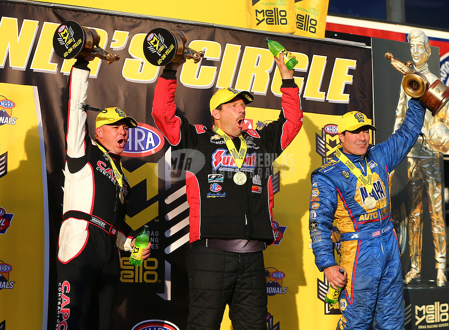 Feb 14, 2016; Pomona, CA, USA; NHRA top fuel driver Steve Torrence (left), pro stock driver Greg Anderson (center) and funny car driver Ron Capps celebrate after winning the Winternationals at Auto Club Raceway at Pomona. Mandatory Credit: Mark J. Rebilas-USA TODAY Sports