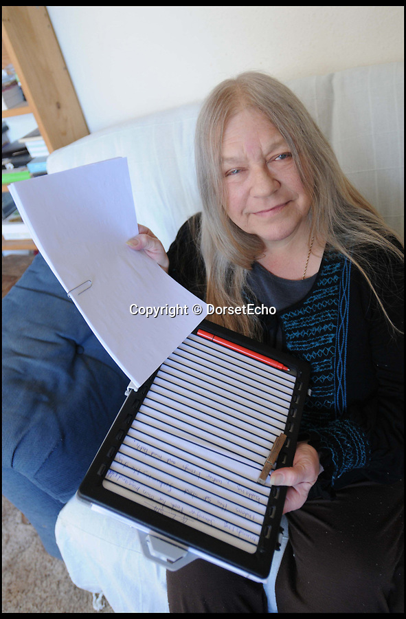 BNPS.co.uk (01202 558833)<br /> Pic: JohnGurd/BNPS<br /> <br /> Trish who sadly died on Wednesday..<br /> <br /> A blind author whose debut novel was saved by police forensic officers after she carried on writing for 26 pages after her ink had run out has died on the eve of publication.<br /> <br /> Trish Vickers, 64, had spent years writing the 110,000 word book Grannifer's Legacy by hand.<br /> <br /> Her dream was nearly ruined five years ago when she discovered she had written 26 pages of nothing after her pen ran out of ink.<br /> <br /> Mrs Vickers, from Charmouth, Dorset, completed the novel in January. She died from cancer on Wednesday and the book is due for release tomorrow (Sat).