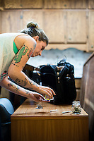 Brittany Driver rolls a joint during a marijuana education class in Denver, Colorado, Saturday, July 20, 2014. <br /> <br /> Photo by Matt Nager