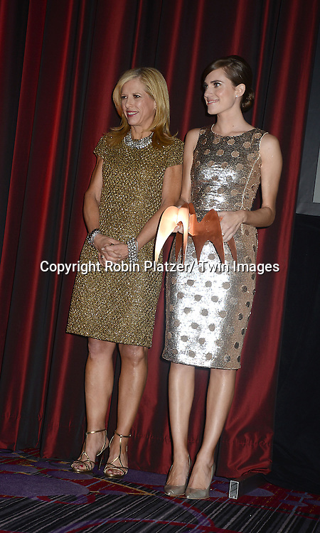 Lucy Danziger and Allison Williams  giving out the first award to Anna Wintour  for Vogue for General Excellence in Service and Fashion at  the National Magazine Awards on May 2, 2013 at the Marriott Marquis Hotel in New York City.