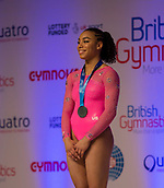 22nd March 2018, Arena Birmingham, Birmingham, England; Gymnastics World Cup, day two, womens competition; Margzetta Frazier (USA) on the podium after receiving her Silver Medal