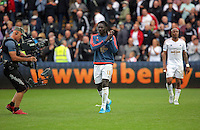 Pictured: Bafetimbi Gomis of Swansea thanks home supporters after the end of the game Sunday 30 August 2015<br /> Re: Premier League, Swansea v Manchester United at the Liberty Stadium, Swansea, UK