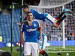 Lee Wallace celebrates goal no 2 as Jason Holt jumps and misses the players, clattering into the advert boards on his own!