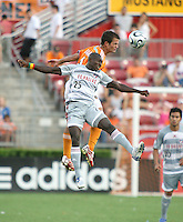 FC Dallas forward Dominic Oduro (25) and Houston Dynamo defender Patrick Ianni (4) go for the header.  Houston Dynamo defeated FC Dallas 1-0 in an MLS regular season match at Robertson Stadium in Houston, TX on August 19, 2007.