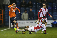 Jack Marriott of Luton Town is tackled by Liam David of Cheltenham Town during the Sky Bet League 2 match between Luton Town and Cheltenham Town at Kenilworth Road, Luton, England on 31 January 2017. Photo by David Horn / PRiME Media Images
