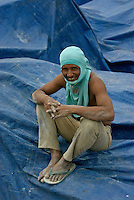 A worker having a rest in one of the many traditional harbors in Jakarta Indonesia