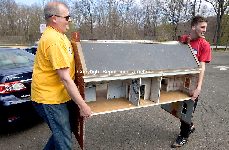 MIDDLEBURY CT. 02 May 2015-050215SV06-From left, Bob Giannini and Drew Hawks both of Middlebury load a large dollhouse into a car for a customer at the Middlebury Congregational Church tag sale and &quot;Old Fashioned Auction&quot; at the Shepardson Community Center in Middlebury Saturday. <br /> Steven Valenti Republican-American