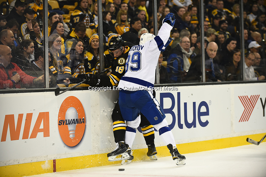 January 13, 2015 - Boston, Massachusetts, U.S. - Tampa Bay Lightning defenseman Nikita Nesterov (89) and Boston Bruins right wing Reilly Smith (18) in game action during the NHL match between the Tampa Bay Lightning and the Boston Bruins held at TD Garden in Boston Massachusetts. Boston defeated Tampa Bay 4-3 in regulation time. Eric Canha/CSM