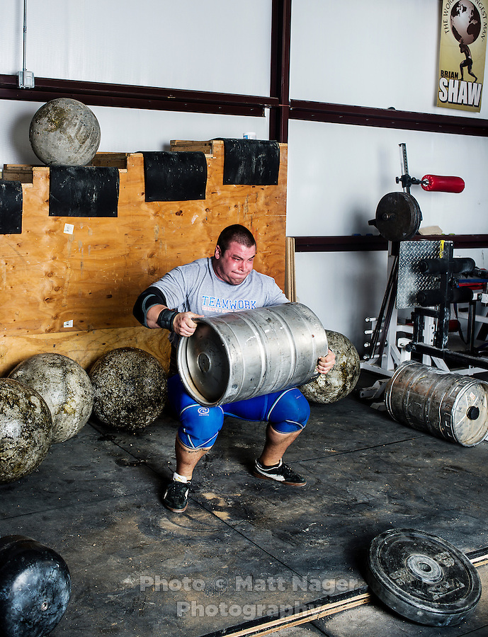 Brian Shaw (cq), Tyler Stickle (cq), and Michael Burke (cq) train for a strongman competition at Shaw's gym in Frederick, Colorado, Saturday, September 21, 2013. <br /> Shaw is the winner of the 2013 Strongman Competition.<br /> <br /> Photo by Matt Nager