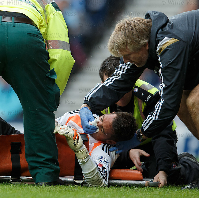 Neil Alexander gets medical attention and is stretchered off