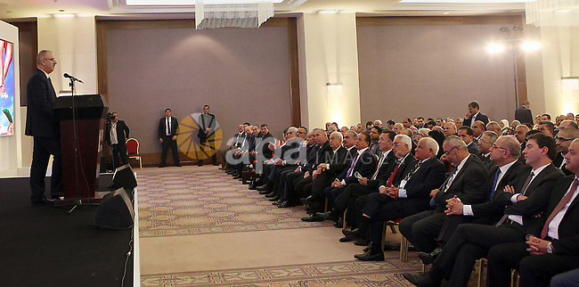 Palestinian Prime Minister Rami Hamdallah speaks during a conference of the Palestinian investors in the homeland and in the Diaspora, in the West Bank city of Ramallah, May 4, 2015. Photo by Prime Minister Offic