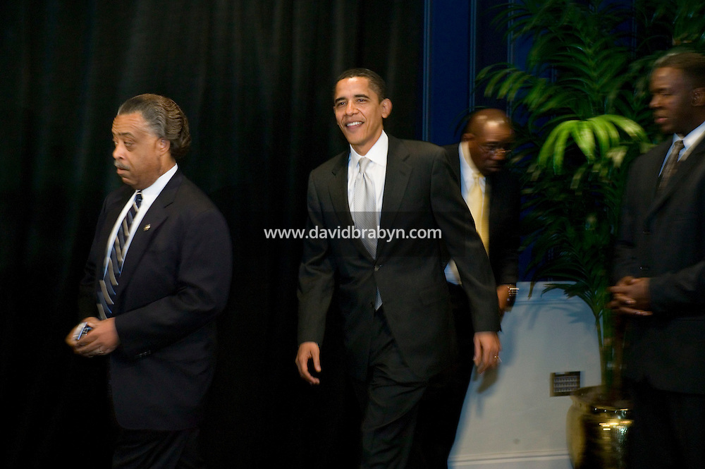 Democratic presidential hopeful Senator Barack Obama (2L) and the Reverend Al Sharpton (L) arrive at a session of the 9th Annual National Action Network Convention in New York City, USA, 21 April 2007.