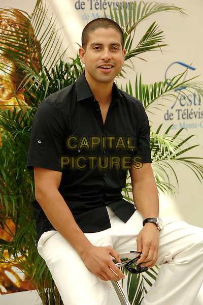 "ADAM RODRIGUEZ.Photocall promoting the television series ""Les Experts: Miami (CSI: Miami)"" on the third day of the 2008 Monte Carlo Television Festival held at Grimaldi Forum, Monaco, Principality of Monaco..June 10th, 2008.half length sitting black shirt .CAP/TTL .© TTL/Capital Pictures"