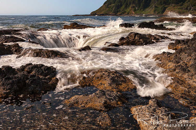Water is drawn into Thor's Well at Cape Perpetua Scenic Area along Oregon's Central Coast south of Yachats.