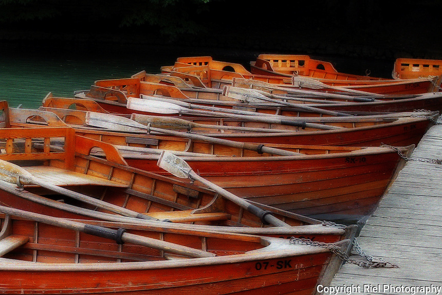 Beautiful wooden row boats line a small pier in Plitvice Lakes National Park.