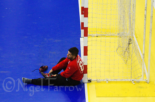 11 JUN 2010 - LONDON, GBR - Cypriot goalkeeper Christophoros Nungovitch recovers after the teams match against Bulgaria at their 2012 European Handball Championships Qualification Tournament .(PHOTO (C) NIGEL FARROW)