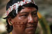 Roraima, Brazil. Chief Davi Yanomami, leader of the Yanomami people and their spokesman, wearing a cotton and feather headdress and with red face paint design.