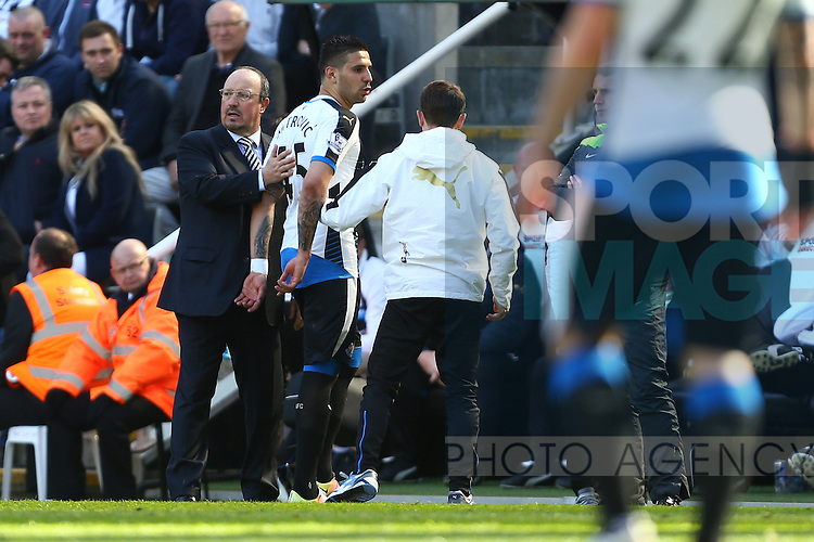Rafa Benitez, manager of Newcastle United consoles Aleksandar Mitrovic following his red card during the Barclays Premier League match at St James' Park. Photo credit should read: Philip Oldham/Sportimage