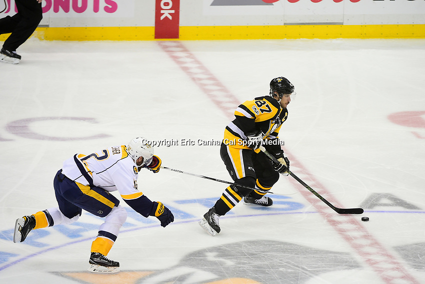 May 31, 2017: Pittsburgh Penguins center Sidney Crosby (87) is chased through the neutral zone by Nashville Predators center Mike Fisher (12) during game two of the National Hockey League Stanley Cup Finals between the Nashville Predators  and the Pittsburgh Penguins, held at PPG Paints Arena, in Pittsburgh, PA. The Penguins defeat the Predators 4-1 and lead the series 2-0. Eric Canha/CSM
