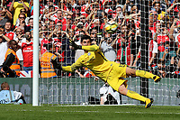 Chelsea goalkeeper, Thibaut Courtois, dives the wrong way and Olivier Giroud's penalty seals the shoot-out victory for Arsenal by four goals to one during Arsenal vs Chelsea, FA Community Shield Football at Wembley Stadium on 6th August 2017