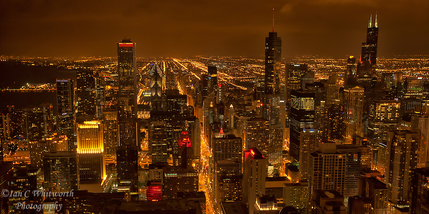 Looking south from the John Hancock Tower at night at the beautiful Chicago skyline.