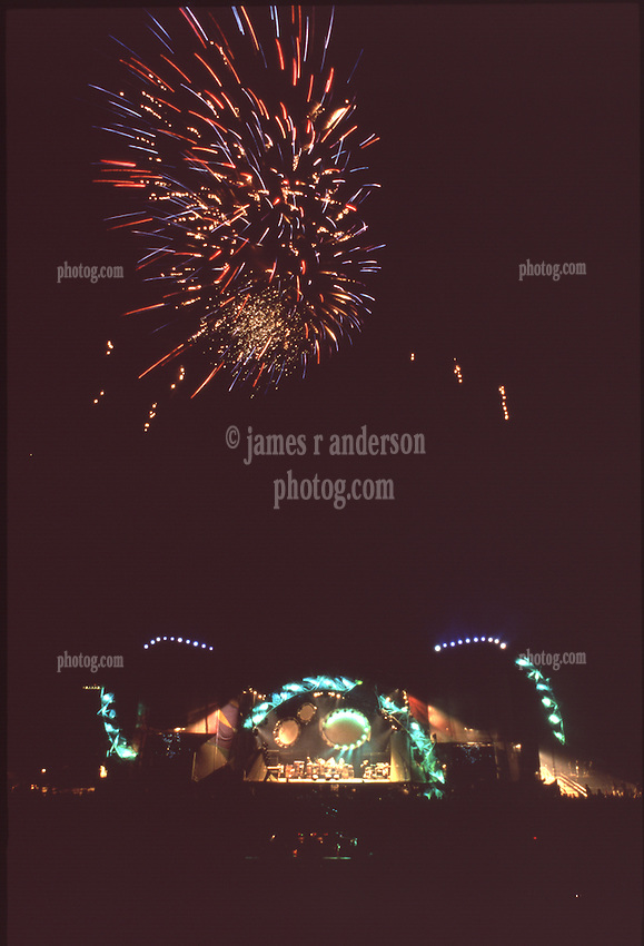 Fireworks after the Show, end of Tour. Grateful Dead Live at Soldiers Field Chicago. The last show ever performed by the band, July 9, 1995. Stage lighting and set design by Candace Brightman. Photographed from the lighting booth for Ms. Brightman and Grateful Dead Productions.