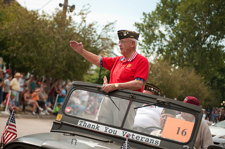 UNITED STATES - AUGUST 15:  Rep. Leonard Boswell, D-Iowa, a Vietnam veteran, salutes a fairgoes during the Veteran's parade at the Iowa State Fair in Des Moines, Iowa.  (Photo By Tom Williams/Roll Call)