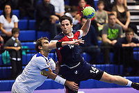 02 NOV 2011 - LONDON, GBR - Britain's Steve Larsson (#14 in blue and red) takes a shot at goal as he is challenged by Israel's Gal Moshe Avraham (left in white) during the Men's 2013 World Handball Championship qualification match at the National Sports Centre at Crystal Palace (PHOTO (C) NIGEL FARROW)