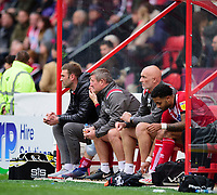(Left to right) Lincoln City's first team coach Jamie McCombe, David Kerslake, Andy Warrington and Bruno Andrade<br /> <br /> Photographer Andrew Vaughan/CameraSport<br /> <br /> The EFL Sky Bet League One - Lincoln City v Sunderland - Saturday 5th October 2019 - Sincil Bank - Lincoln<br /> <br /> World Copyright © 2019 CameraSport. All rights reserved. 43 Linden Ave. Countesthorpe. Leicester. England. LE8 5PG - Tel: +44 (0) 116 277 4147 - admin@camerasport.com - www.camerasport.com