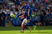 Joe Bennett of Cardiff City clears from Scott Hogan of Aston Villa during the Sky Bet Championship match between Cardiff City and Aston Villa at the Cardiff City Stadium, Cardiff, Wales on 12 August 2017. Photo by Mark  Hawkins / PRiME Media Images.