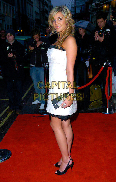 DANIELLE LLOYD.Arrives at The Dover Street Restaurant & Bar Charity Dinner, London, England, May 15th 2007..full length black and white dress clutch bag Dannielle tanned.CAP/CAN.©Can Nguyen/Capital Pictures