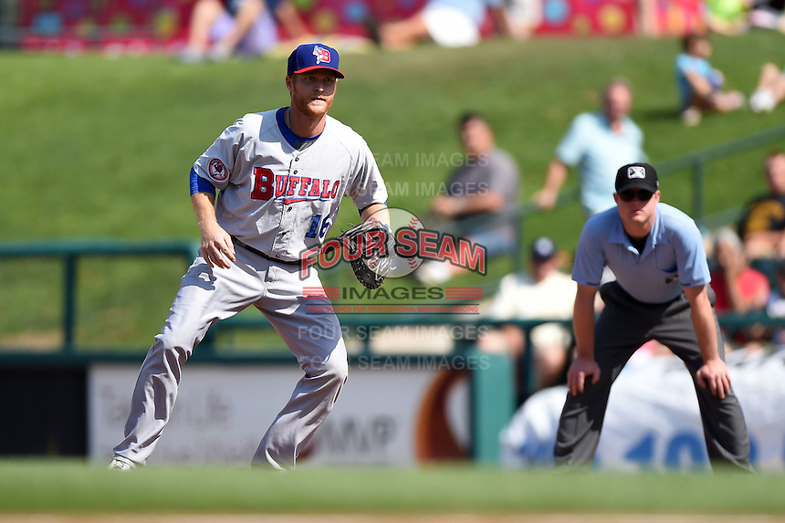 Buffalo Bisons designated hitter Dan Johnson (16) in position in front of umpire Joseph Born during the first game of a doubleheader against the Rochester Red Wings on July 6, 2014 at Frontier Field in Rochester, New  York.  Rochester defeated Buffalo 6-1.  (Mike Janes/Four Seam Images)