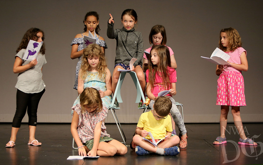 NWA Democrat-Gazette/DAVID GOTTSCHALK   Ava Carter (center) rehearses her lines Thursday, July 6, 2017, with campers participating in the Readers Theatre with Page Darragh during The New School Summer Camp 2017 on the campus in Fayetteville. The school is offering 50 different camps for ages first through eighth grades. The camps are taught by New School teachers and professionals in the community. This week first through third grade students are participating in theatre,  Sporty Craft Camp and Minecraft Design and Engineering.