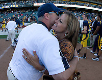 California head coach Jeff Tedford hugs his wife, Donna Tedford after winning 75th victory during his CAL coach career at AT&T Park in San Francisco on September 17th, 2011.  California defeated Presbyterian, 63-12.