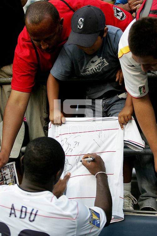 Freddy Adu signs a jersey for fans after the game. USA defeated Grenada 4-0 during the First Round of the 2009 CONCACAF Gold Cup at Qwest Field in Seattle, Washington on July 4, 2009.