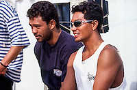 Sunny Garcia (HAW) and travelling partner Kaipo Jaquias (HAW) during the running of the Gotcha Lacanau Pro at Lacanau Beach, in the South West of France. Circa 1995. . Photo: joliphotos.com