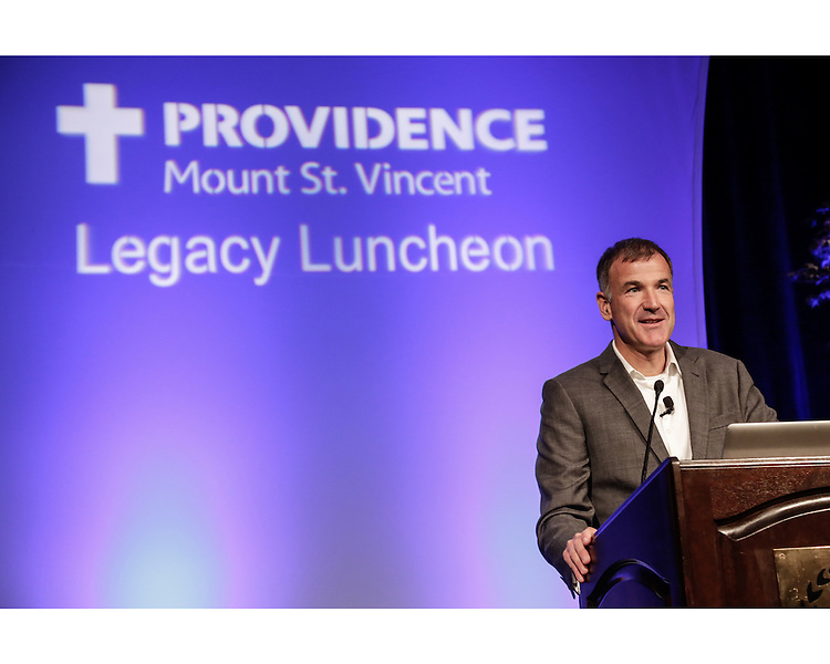 National geographic photographer, DAvid McLain, speaks at Providence Mount St. Vincent's Legacy Luncheon fundraiser.