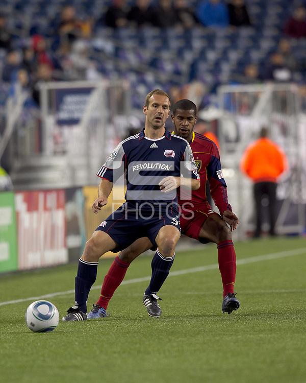 New England Revolution forward Ilija Stolica (9) passes as Real Salt Lake defender Rauwshan McKenzie (30) defends. In a Major League Soccer (MLS) match, Real Salt Lake defeated the New England Revolution, 2-0, at Gillette Stadium on April 9, 2011.