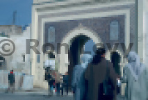 Arabs walking near archway entrance to kasbah, Tangier, Morocco