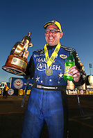 Nov 13, 2016; Pomona, CA, USA; NHRA funny car driver Tommy Johnson Jr celebrates after winning the Auto Club Finals at Auto Club Raceway at Pomona. Mandatory Credit: Mark J. Rebilas-USA TODAY Sports