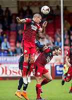 Jimmy Smith of Crawley Town clears during the Sky Bet League 2 match between Crawley Town and Wycombe Wanderers at Checkatrade.com Stadium, Crawley, England on 29 August 2015. Photo by Liam McAvoy.