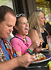 July 16, 2005: Riley Kinsella, 13, center, parents Gene Kinsella, left, and Shannon Kinsella, right, enjoy Saturday brunch at the Frontera Grill in Chicago. The popular restaurant is owned by Chef Rick Bayless. Photo by Kevin J. Miyazaki/Redux for The New York Times