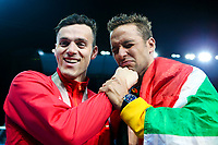 Picture by Alex Whitehead/SWpix.com - 09/04/2018 - Commonwealth Games - Swimming - Optus Aquatics Centre, Gold Coast, Australia - Chad le Clos of South Africa wins Gold and James Guy of England wins Silver in the Men's 100m Butterfly final.