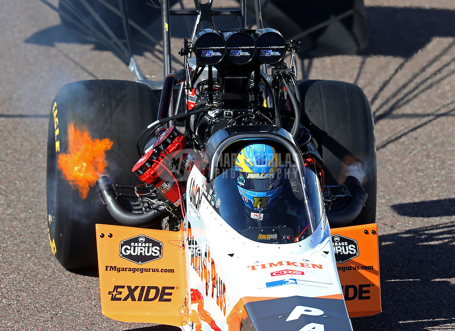 Feb 25, 2017; Chandler, AZ, USA; Fire comes from the exhaust header pipe on the dragster of NHRA top fuel driver Clay Millican during qualifying for the Arizona Nationals at Wild Horse Pass Motorsports Park. Mandatory Credit: Mark J. Rebilas-USA TODAY Sports