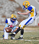 Borgia player Luke Kloeppel holds the ball for kicker Jake Nowak as he connects on this punt after a Borgia touchdown. Roosevelt defeated Borgia in a Class 3 District 2 football game at Roosevelt HS in St. Louis on Saturday November 16, 2019. <br /> Tim Vizer/Special to STLhighschoolsports.com