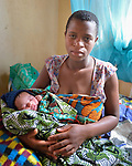Mary Zimba and her newborn daughter Etiness at the Mhalaunda Health Centre in Mhalaunda, Malawi. The centre, where women from the surrounding countryside come to safely give birth, is supported by the Maternal, Newborn and Child Health program of the Livingstonia Synod of the Church of Central Africa Presbyterian.