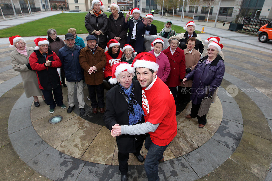 NO FEE PICTURES.30/11/11 Fair City Stars Ciara O'Callaghan (Yvonne Doyle) and Sam O'Mahony (Finn McGrath) with a group of older persons who use ALONE, at the launch of ALONE Christmas Campaign in Dublin. Pictures:Arthur Carron/Collins